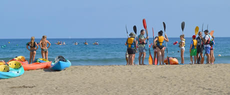 youth canoeing on beach
