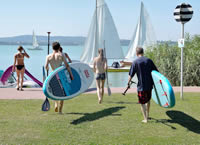 stand-up-paddleboarding and sailing